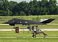 US Navy 030717-N-9693M-001 A Wright B Flyer replica taxis past a United States Air Force F-117A Stealth Fighter during the U.S. Air and Trade Show.jpg