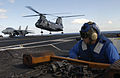 US Navy 031103-N-6713R-064 Aviation Boatswain's Mate Airman Thomas Brehm observes the landing of a CH-46 Sea Knight.jpg