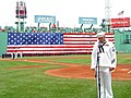 US Navy 040531-N-4518T-010 USS Constitution crew member Builder 1st Class Kevin Dougherty, sings the National Anthem at Boston's Fenway Park.jpg