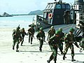 US Navy 040708-N-1050K-021 Royal Thai Marines storm ashore from a U.S. Navy Landing Craft Air Cushioned (LCAC) during an amphibious raid event as part of the Thailand phase of exercise Cooperation Afloat Readiness and Training.jpg
