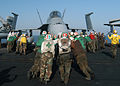 US Navy 040923-N-4565G-002 Flight deck personal conduct a push back on an F-A-18B Hornet.jpg