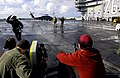 US Navy 050304-N-8213G-039 A member of an NBC television crew shouts Roll Camera, ACTION^ as he runs to the back of the set for a new television show called Fathom during filming on the flight deck aboard USS Ronald Reagan (CVN.jpg