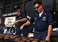 US Navy 050917-N-7202W-012 Crew members assigned aboard the amphibious assault ship USS Iwo Jima (LHD 7), cooks for the community workers in New Orleans during hurricane relief efforts.jpg