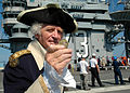 US Navy 050926-N-1045B-017 A General George Washington impersonator, William A. Sommersfield, displays a ship's commemorative coin during his visit aboard the Nimitz-class aircraft carrier USS George Washington (CVN 73).jpg