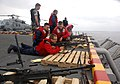 US Navy 060812-N-5914D-005 Self Defense Force members assigned to the amphibious assault ship USS Boxer (LHD 4) maintains their proficiency firing an M-60 machine gun.jpg