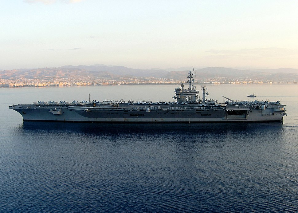 US Navy 061025-N-2835F-001 The flagship for Commander, Carrier Strike Group Eight (CCSG-8), Nimitz-class aircraft carrier USS Dwight D. Eisenhower (CVN 69), anchors off the coast of Cyprus for a port visit