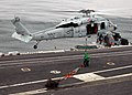 US Navy 071103-N-9898L-203 Sailors attach a hoisting cable to an MH-60S Seahawk, assigned to the.jpg