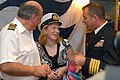 US Navy 080106-N-0555B-013 Laura Montero, center, speaks with Ronald Reagan Commanding Officer Capt. Terry B. Kraft, right, and Dawn Princess Commanding Officer Capt. Marco Fortezze during a luncheon.jpg