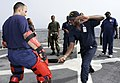 US Navy 080616-G-2443T-010 t. Placido Ndong, a member of the Equatorial Guinea Navy, practices maritime-law enforcement self-defense techniques with Petty Officer 1st Class Marcus Pereira.jpg