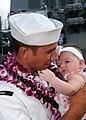 US Navy 081001-N-9758L-129 oatswain's Mate Seaman Ryan Cook hugs his daughter after the ship moors at Naval Station (NAVSTA) Pearl Harbor.jpg