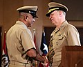 US Navy 081212-N-0426B-058 Chief of Naval Operations (CNO) Adm. Gary Roughead speaks with retired Master Chief Petty Officer of the Navy (MCPON) Joe R. Campa Jr. during the passing of the cutlass ceremony and Campa's retirement.jpg