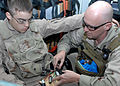 US Navy 090121-N-4750W-015 Explosive Ordnance Disposal Specialist 1st Class Mark Hickling disengages an explosive device.jpg
