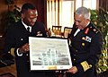 US Navy 090223-N-1907H-036 Cmdr. Eric Cash, left, commanding officer of the amphibious transport dock ship USS San Antonio (LPD 17), presents a framed photo to Egyptian Rear Adm. Gamal Ezz Eldin, commander of Alexandria Naval B.jpg