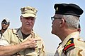 US Navy 090822-N-8273J-246 Chief of Naval Operations (CNO) Adm. Gary Roughead, right, visits the Iraqi Navy patrol ship Fetah (701) with Cmdr. Ahmed Jasim, commanding officer of Umm Qasr Naval Base.jpg