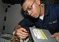 US Navy 091028-N-5712P-015 Information Systems Technician Seaman Apprentice Miles Yu, assigned to the amphibious assault ship USS Nassau (LHA 4).jpg
