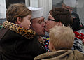 US Navy 091125-N-7179M-084 Machinist's Mate 1st Class William H. Kern receives the traditional first kiss from his wife after returning to Naval Station Norfolk after a six-month deployment aboard the Los Angeles-class attack s.jpg