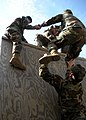 US Navy 091210-N-8816D-027 Seabees assigned to Naval Mobile Construction Battalion (NMCB) 133 scale an obstacle.jpg