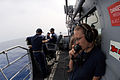US Navy 100603-N-0553R-059 Yeoman Seaman Britanny Engbrecht, embarked aboard the guided-missile cruiser USS San Jacinto (CG 56), conducts a communications check.jpg