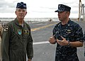 US Navy 100824-N-6764G-145 Lt. Greg Hill explains flight deck operations of USS Kearsarge (LHD 3) to Gen. Douglas Fraser.jpg