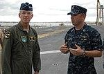 US Navy 100824-N-6764G-145 Lt. Greg Hill explains flight deck operations of USS Kearsarge (LHD 3) to Gen. Douglas Fraser.jpg