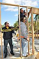 US Navy 110311-N-DD445-003 Sailors assigned to the guided-missile frigate USS Klakring (FFG 42), construct frames for a Habitat for Humanity home a.jpg
