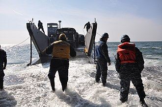 Operation Tomodachi - A U.S. landing craft moves Japan Defense Force vehicles