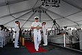 US Navy 110709-N-XD424-114 U.S. Pacific Fleet Master Chief John Minyard carries the remains of Harold B. Estes during a memorial ceremony aboard th.jpg