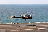 A Pakistan navy SA-319B Alouette III helicopter lands aboard the aircraft