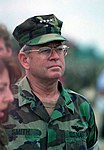 US Navy Adm. Leighton Smith listens to a question as he accompanies the honorable William J. Perry (not seen) through Camp McGovern, Bosnia and Herzegovina.jpg