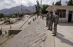 US soldiers patrolling the streets of Asadabad