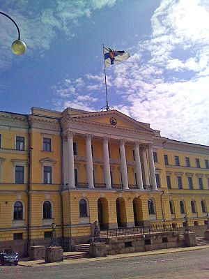 Flag of Finland - The headquarters of the Finnish Government on Senate Square, Helsinki, seen flying the State flag.