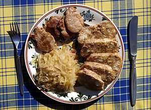 Czech cuisine - Vepřo-knedlo-zelo (Roast pork with dumplings and sauerkraut)