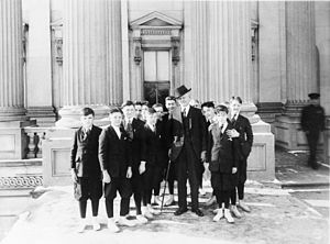 United States Senate Page - A group of Senate pages with Vice President Thomas R. Marshall on the steps of the Capitol, c. 1913-1921