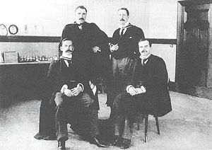 Thomas Hill Easterfield - Thomas Hill Easterfield (back right) seated with the other founding professors of Victoria University of Wellington.
