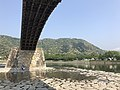 View of Tenshu of Iwakuni Castle beneath Kintaikyo Bridge 2.jpg