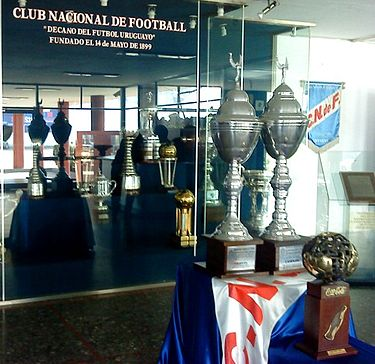 Some of the trophies won by Nacional in its history, exhibited at the club. VitrinasCNdeF.jpg