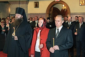 Vladimir Putin (right) and his wife attend a commemoration service for the victims of the terrorist attacks, November 16, 2001. Vladimir Putin in the United States 13-16 November 2001-54.jpg