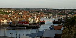 The harbour and marina at Whitby, with the swing bridge in the middle ground and buildings surrounding the water