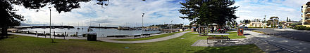 Wollongong Harbour including Belmore Basin, Brighton Beach, the Breakwater Lighthouse and the Head Lighthouse. Wollongong Harbour, New South Wales.jpg