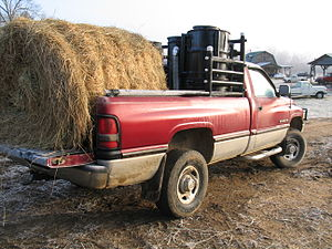Wood gas generator - Dodge V10 hauling hay with woodgas. Keith gasifier system.