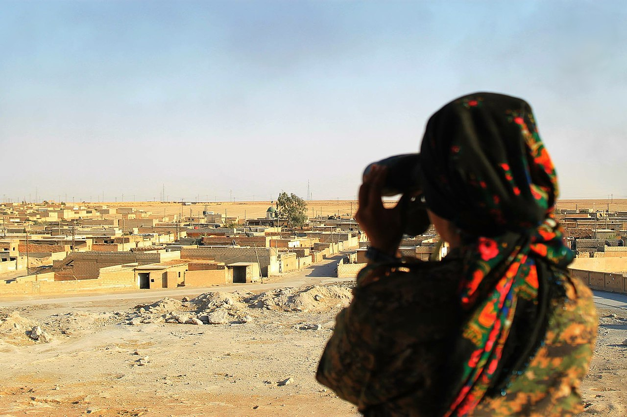 YPJ fighter looking over city.jpg