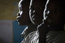 Young Congolese boys during a lesson at the Mugosi Primary School.jpg