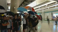 Yuen Long Station passenger use umbrella to protect 20190721.png