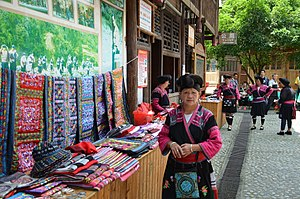 Woman selling textiles at an outdoor market