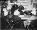 """Air raid wardens at a sector meeting in Washington, DC, discuss the zones they control during a practice air raid."", ca - NARA - 535827.tif"