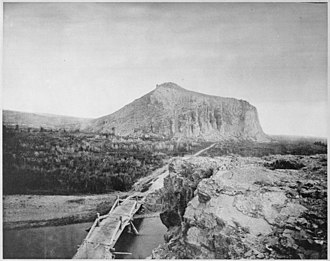"""National Register of Historic Places listings in Madison County, Montana - Image: """"The overland stage road between Ogden and Helena crossing the Beaver Head River at Point of Rocks ... by means of a pla NARA 520085"""