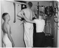 (Pharmacist mate conducting chest x-rays on one sailor while another sailor waits his turn at the Naval Training... - NARA - 295584.tif
