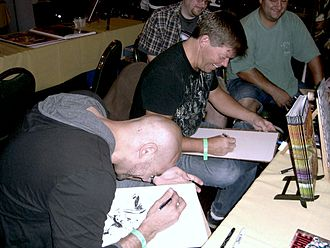 Rob Liefeld - Liefeld and Marat Mychaels share a laugh as they sketch at the Big Apple Convention in Manhattan, October 2, 2010