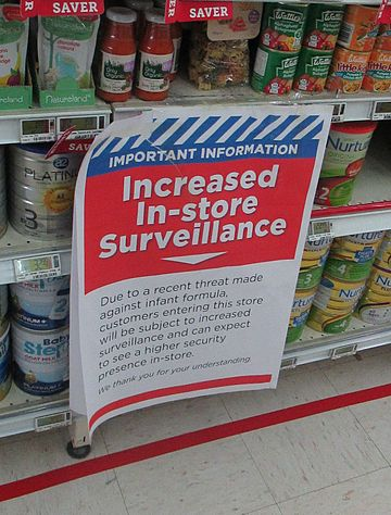 Sign notifying shoppers of increased surveillance due to a perceived increased risk of terrorism 1080 Poisoning Scare At New World in Wellington.jpeg