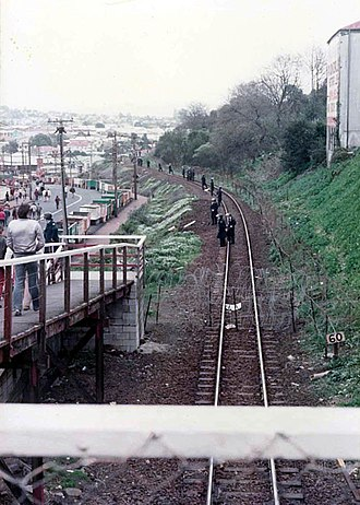 1981 South Africa rugby union tour of New Zealand and the United States - Police officers guarding a barbed wire perimeter around Eden Park near Kingsland Railway Station.